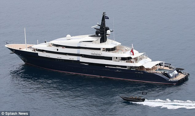 The boat, being steered by one of the actors, came close to one of the large yachts in the French Riviera