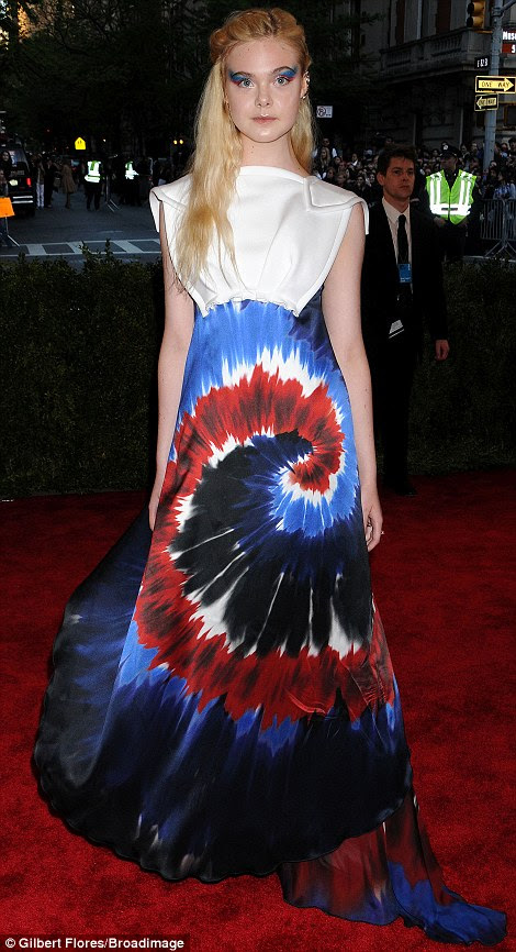 Optical illusion: Elle Fanning gave Joseph and his technicolour dreamcoat a run for its money with her mind-boggling dress design