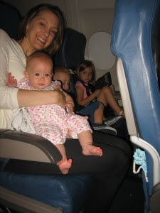 Surprise!! Friends on the flight to Utah! (Carrie flew with four kids... brave woman! The youngest is Poppy, she's two weeks older than Cambria