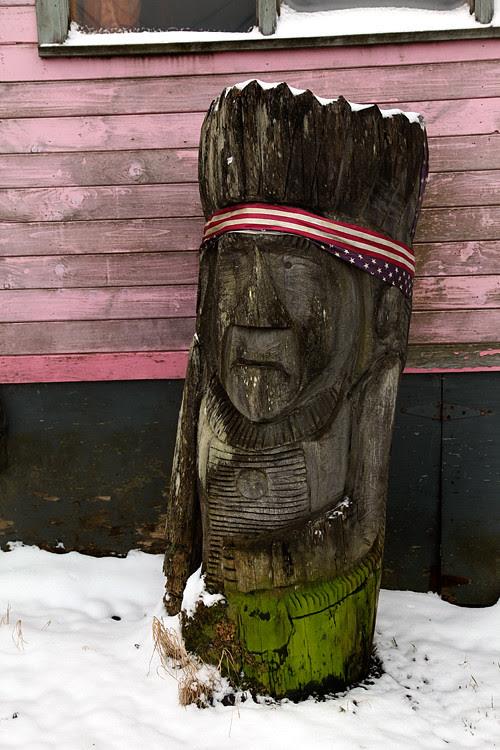 wood sculpture and snow, Craig, Alaska