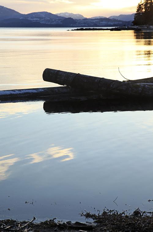 log boom at sunset, mouth of Son-i-Hat Creek, Kasaan, Alaska