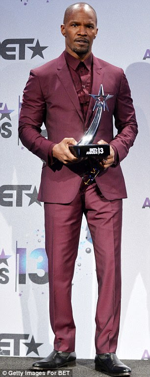 Purple patch: Jamie Foxx posed backstage with with his Best Actor Award while Olympian Gabrielle Douglas won the YoungStars Award
