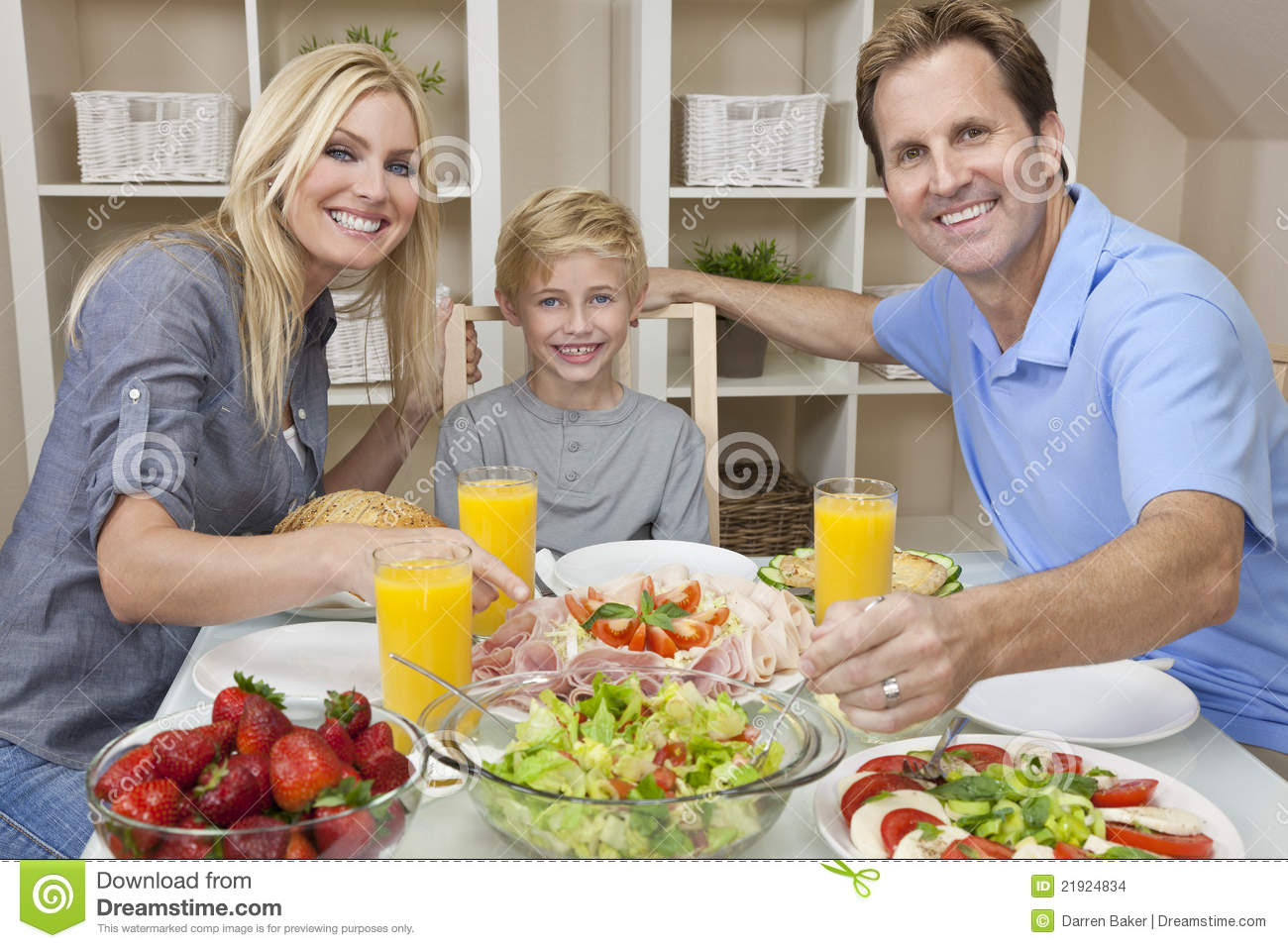 Parents Child Family Healthy Food At Dining Table Stock Images ...