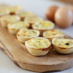 Looking for tasty, elegant finger foods for your next gathering? These mini cheesy quiches are delicious and pretty!