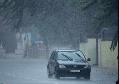 <p>A car passes through a road in Thiruvananthapuram as rain continues in the state (TOI Photo)<br></p>