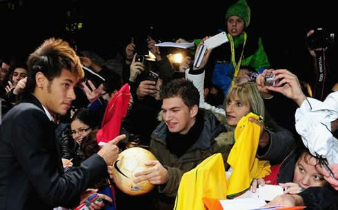 Neymar signing autographs at FIFA's Balon d'Or 2011-2012 gala and ceremony