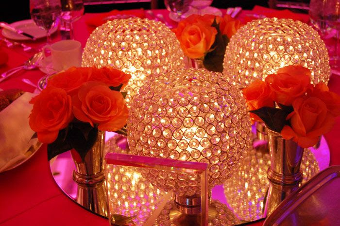 CAPITOL STYLE- Karen Gruson worked with Frank Rea of Forget Me Not Flowers to create centerpieces of orange roses and crystal candleholders.