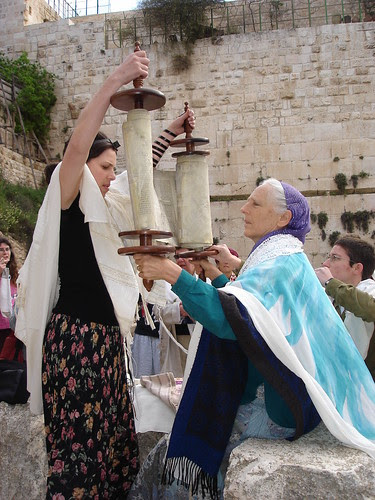Women and Torah scroll