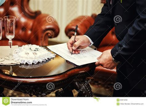 Wedding Ceremony.Man Signing Marriage Contract, Closeup
