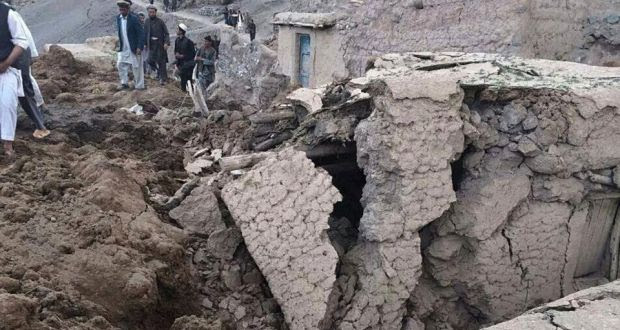 Afghan villagers gather at the site of a landslide at the Argo district in Badakhshan province yesterday. Photograph: Reuters