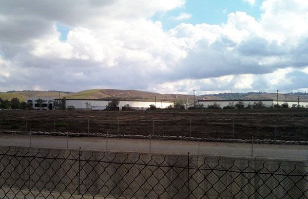 Warehouses in the distance.