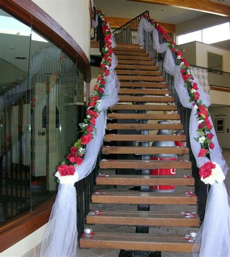 Stairway decorated with White Tulle and Red Silk Roses