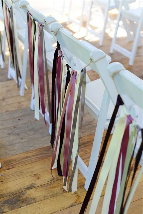 CHAIR DECOR. Decorate chairs with simple lengths of ribbon