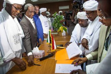 Representatives of Sudan (left) and leaders of Abbala and Beni Hussein ethnic groups (right) sign the document of agreement in the North Darfur Wali (Governor) residence in El Fasher, North Darfur. by Pan-African News Wire File Photos