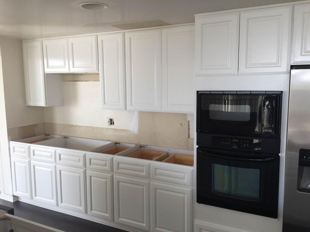 kitchen white raised panel cabinets & black quartz ...