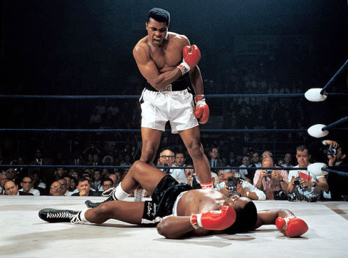 Muhammad Ali stands over Sonny Liston after knocking him out in the first round of their 1965 fight. (Neil Leifer/SI)