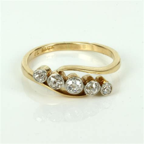 Buy Twist design antique 5 stone diamond engagement ring