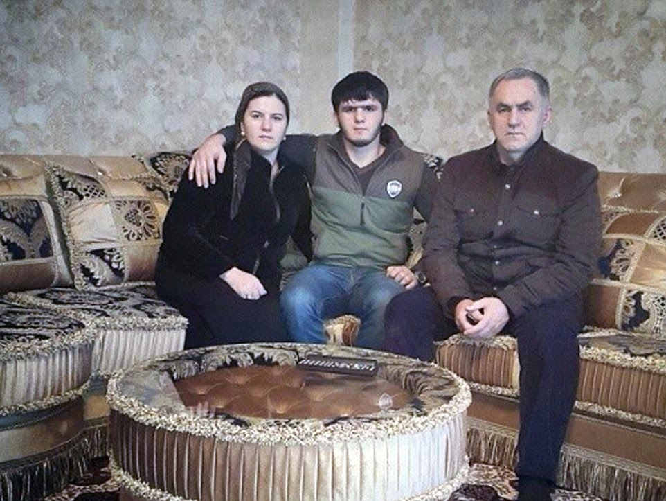 Polygamous: Nazhud Guchigov (right) with his first wife, to whome he is still married, and his son in a picture posted on Instagram