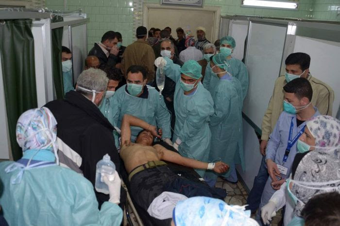 Hospital workers attend injured in alleged Aleppo chemical attack