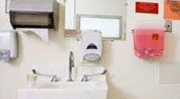 Health Care Facility Cleaning Station with Soap, Sanitizer, Towels, and Sharps Container near Sink
