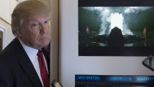 """US President Donald Trump speaks to the press on Air Force One on April 6, 2017. Chinese President Xi Jinping touched down in Florida Thursday for a first face-to-face meeting with President Donald Trump, hoping that a basket full of """"tweetable"""" deals will help avoid a public clash.Trump had yet to arrive to Florida, but the pair will gather later at his Mar-a-Lago resort -- which the US president likes to call the """"Winter White House"""" -- for what promises to be a masterclass in studied informality. / AFP PHOTO / JIM WATSON        (Photo credit should read JIM WATSON/AFP/Getty Images)"""