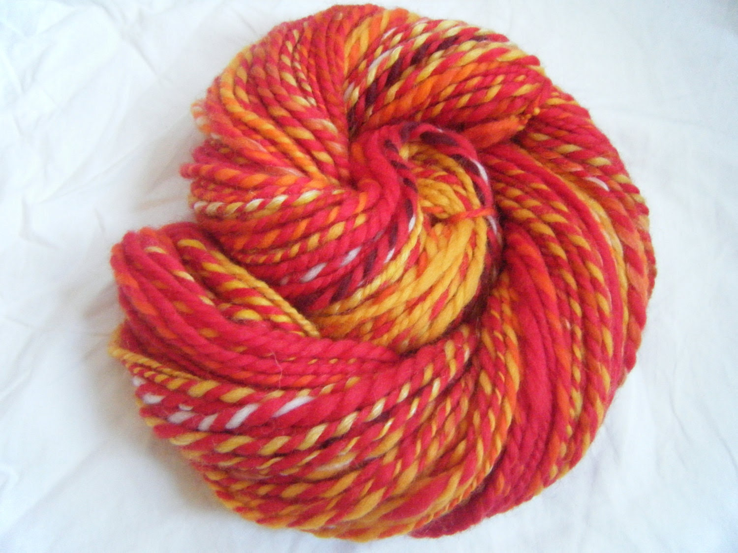 Orange and red, handspun 2-ply merino yarn, 95 yards, 65g