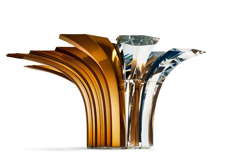 zaha hadid merges metal and crystal to form centerpiece for swarovski