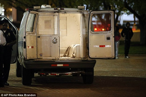 Example: This photograph from earlier in the week shows a Baltimore Police version of the van, similar to the one driven by Caesar Goodson but in order to win a conviction, city prosecutors will have to convince a jury that  Goodson acted so recklessly that he knew his actions could take Gray's life