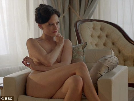 Raunchy pre-watershed scenes: Lara Pulver, who plays Sherlock Holmes love interest Irene Adler strips off in this scene from the BBC adaptation