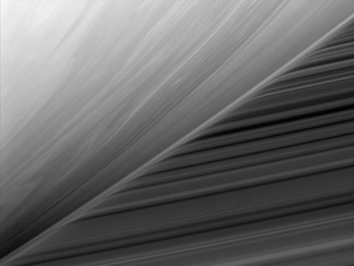 This weird view shows how Saturn's outer atmosphere distorts light from rings located behind it.