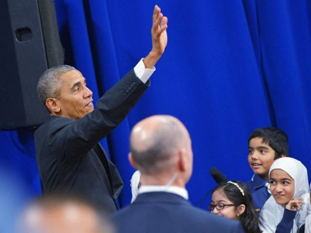 Barack Obama waves after greeting attendees in an overflow room at the Islamic Society of Baltimore, in Windsor Mill, Maryland on February 3, 2016.
