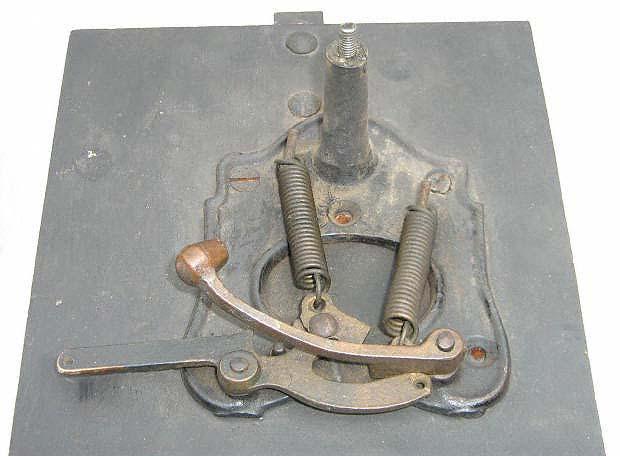 Bell trip mechanism.
