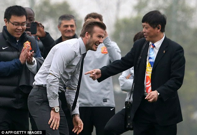 Good spirits: Beckham laughed off his fall during his visit to China