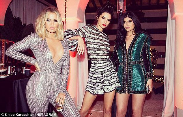 Sister sandwich:She posed next to Khloe, in a plunging jumpsuit, and Kylie, who had on a short green Balmain dress