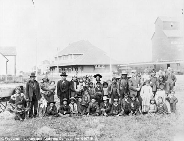 A group of students and parents from the Saddle Lake Reserve in Alberta en route to the Methodist-operated Red Deer Indian Industrial School, Alberta