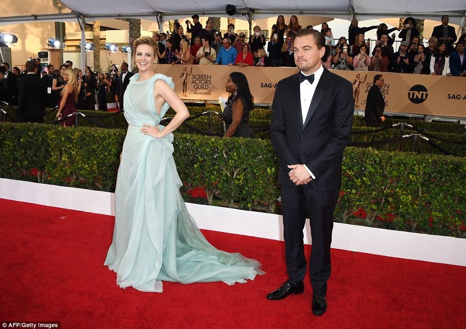 Star-studded: Jones was pictured posing by movie veteran Leonardo DiCaprio