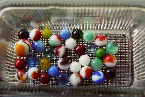 marbles in a glass salt box.