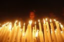 A girl lights candles during a candlelight vigil for a gang rape victim who was assaulted in New Delhi, in Kolkata