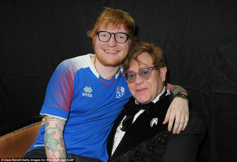 Pals: Ed wrapped his arm around Elton while they caught up backstage