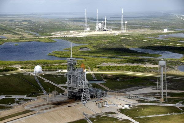 Space shuttle ATLANTIS (foreground) and ARES I-X (background) at Kennedy Space Center's Launch Complex 39, on October 23, 2009.