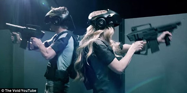 A virtual reality system called The Void plans to open next summer and is allowed players to test out levels of its immersive video game. Above, two gamers with the headsets and virtual guns used