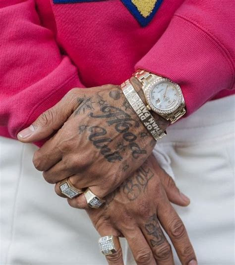 nipsey hussles tattoos meaning body art guru
