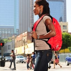 Woman in San Francisco carrying red Fitmark Sport Backpack