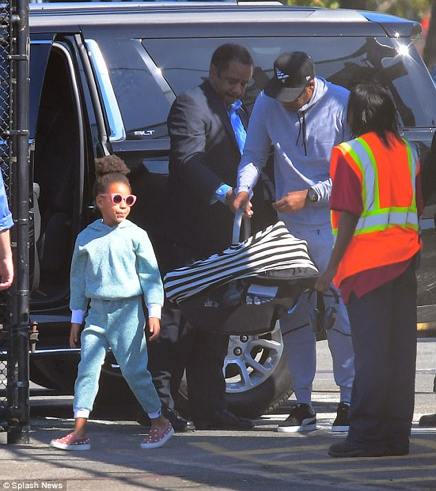 Like her momma: Blue Ivy looked rather stylish in her tracksuit and shades