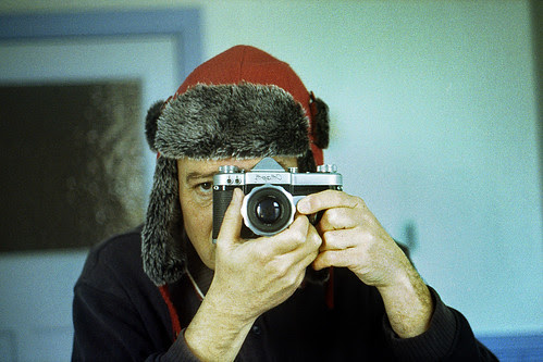 reflected self-portrait with Cmapm camera and red trapper hat (landscape) by pho-Tony