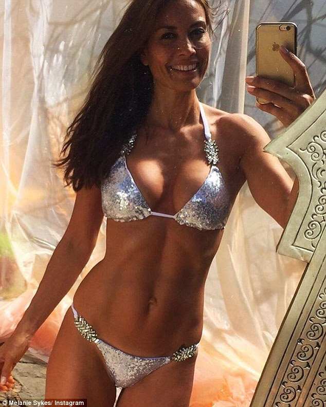 All that glitters! Melanie Sykes, 46, showed off her gym-honed physique while on holiday in Mallorca on Sunday, flaunting her washboard abs on Instagram in an all-over sequin bikini