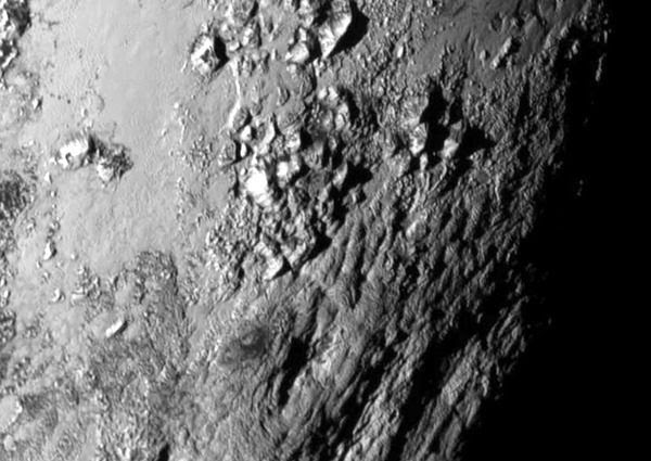 A close-up image of huge mountains composed of water ice on the surface of Pluto...as seen by NASA's New Horizons spacecraft on July 14, 2015.