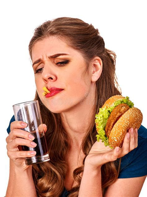 Unhappy Couple Girl Eating Fast Food. Stock Photo   Image
