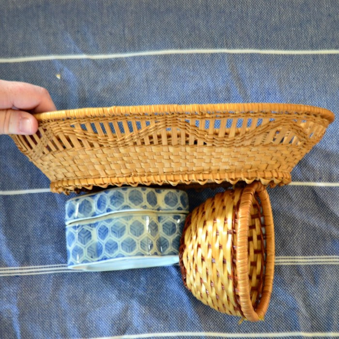 sides of woven baskets and ceramic blue and white container