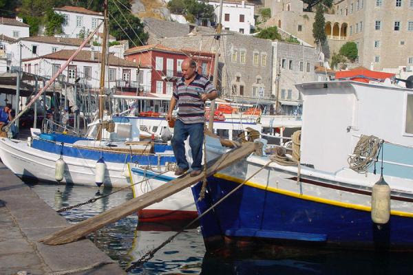 Photograph of Fisherman on boat, Hydra - Greece - Europe